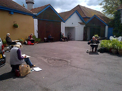 Artists in the courtyard at Yapp HQ