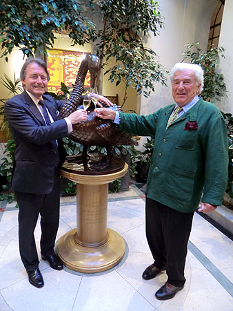 Steven Spurrier and Christian Imbert toast the Vintners' magnificent swan statue.