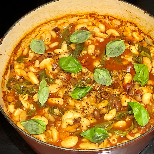 Spinach and Borlotti Bean Minestrone with Macaroni, Chilli Oil and Pine Nuts
